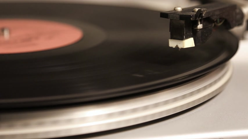 agulha : Start and stop playing a vinyl record