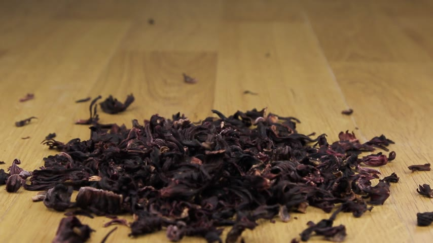 hibiscus tea : Hibiscus falls on a pile on a wooden surface