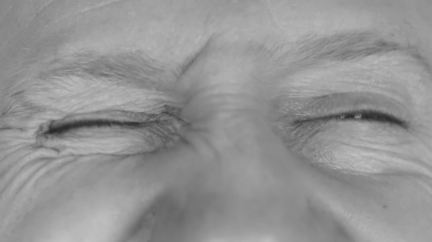 ostoba : Close-up in black and white on  mans eyes, winking eyes. HD Stock mozgókép
