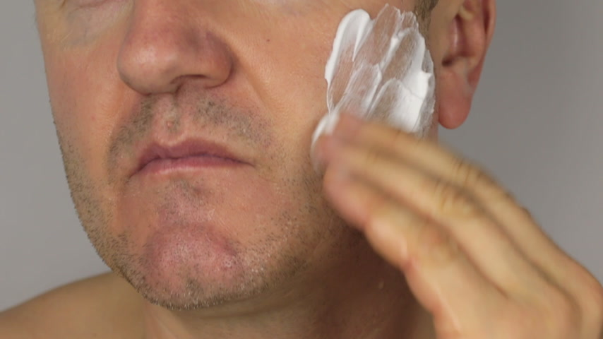 barbear : Closeup  shave a man, use shaving foam on face. HD