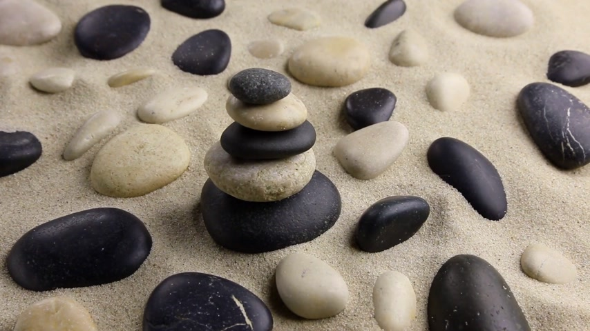 harmonia : Stones pyramid on sand standing among the rocks, harmony, balance,motion.