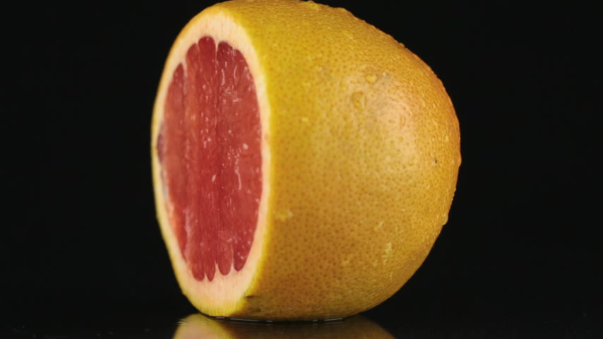 grejpfrut : Half of grapefruit, rotating on a black background. HD