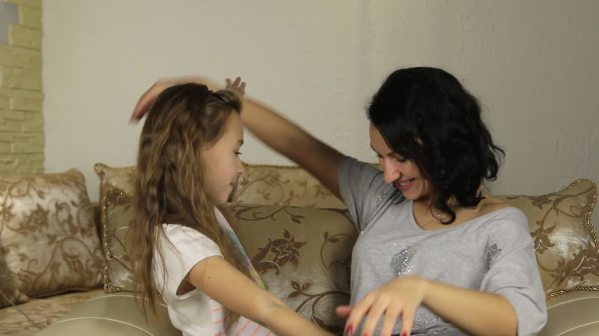 csók : Mother kissing and playing with her daughter. Stock mozgókép