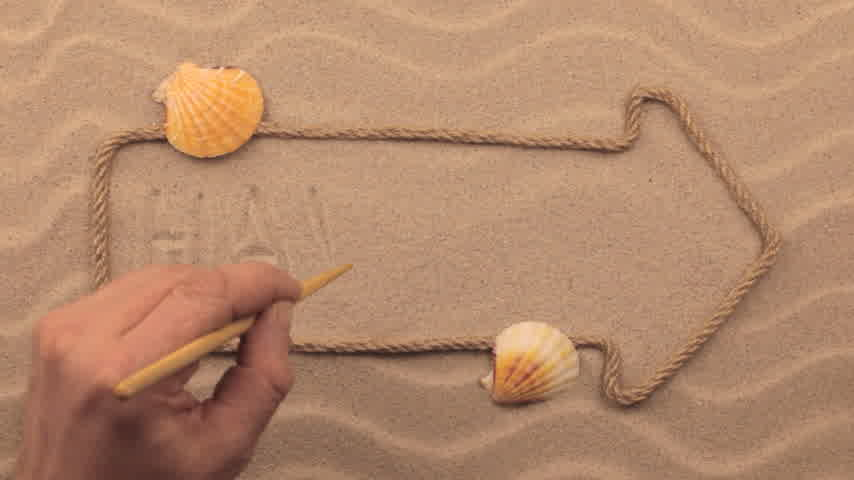 szavak : Hawaii inscription written by hand on the sand, in the pointer made from rope.