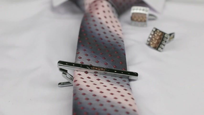 eleganckie : Video of red tie and cufflinks lying on a white shirt. Dolly shot. Close-up. Wideo