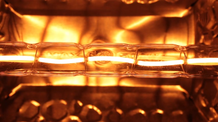 flasks : Flicker of a yellow tungsten spiral of a halogen bulb. Stock Footage