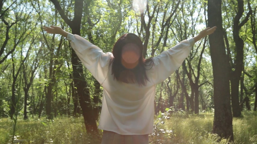 one by one : Woman raise hands in sunny forest, close-up. Smiling relaxed girl. Stock Footage