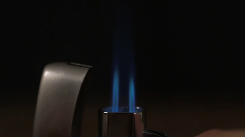 turbo : Close-up, ignite turbo lighter with double flames.