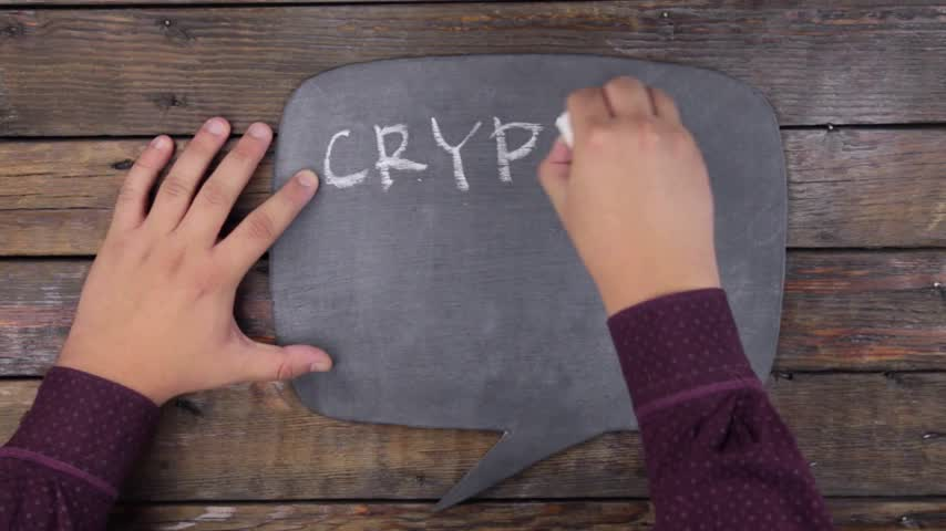 thought : Man writes the word CRYPTOCURRENCY with chalk on a chalkboard, stylized as a thought.