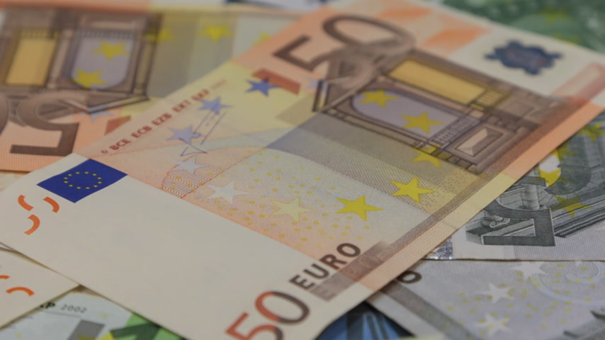 euro banknotes : Close-up, the rotation of a heap of euros.