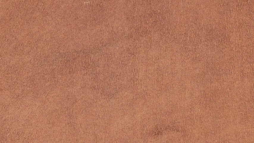 yumuşaklık : Rotation of natural suede leather. Brown chamois texture. Fluffy and soft shammy-leather.