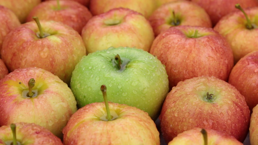 grande grupo de objetos : Close-up. The rotation of the background made from apples.
