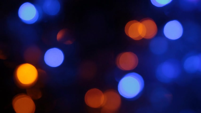 desfocado : Rotation of Christmas multicolored defocused lights. Stock Footage