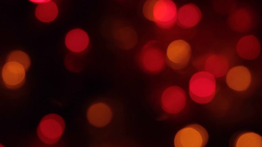 desfocado : Rotation of bokeh, garland flashing lights on a black background.