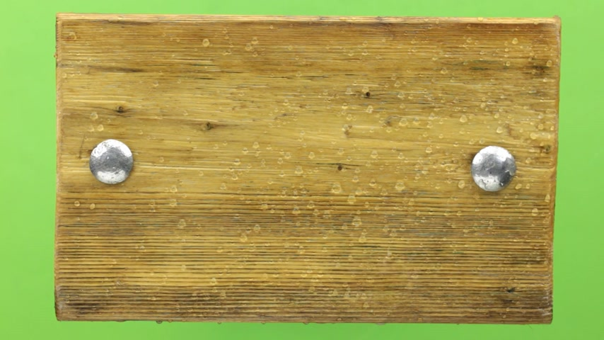 perçin : Raindrops fall on a wooden frame, isolated on green. Stok Video