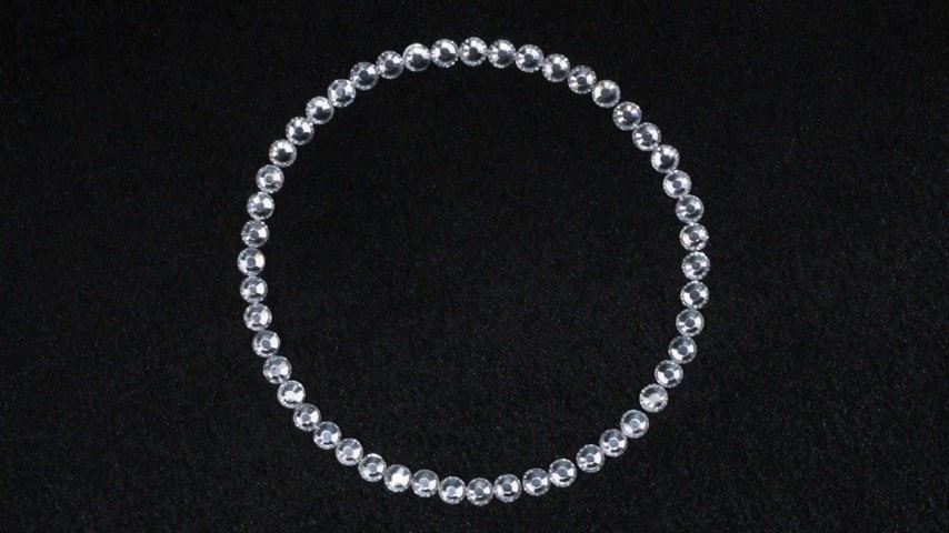 concêntrico : Rotation of a circle made of silver rhinestones, the symbol of infinity. Top view. Vídeos