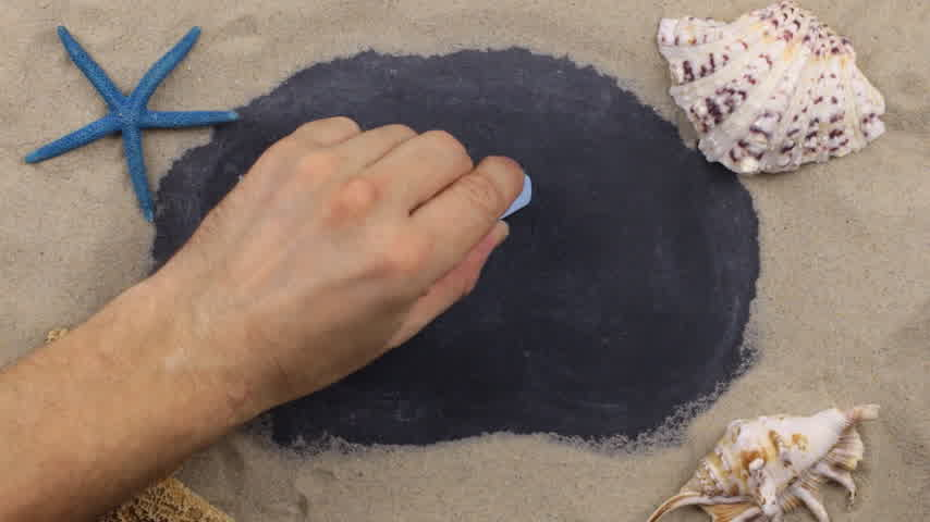 yazılı : Handwritten word PHUKET written in chalk, among seashells and stars. Top view. Stok Video