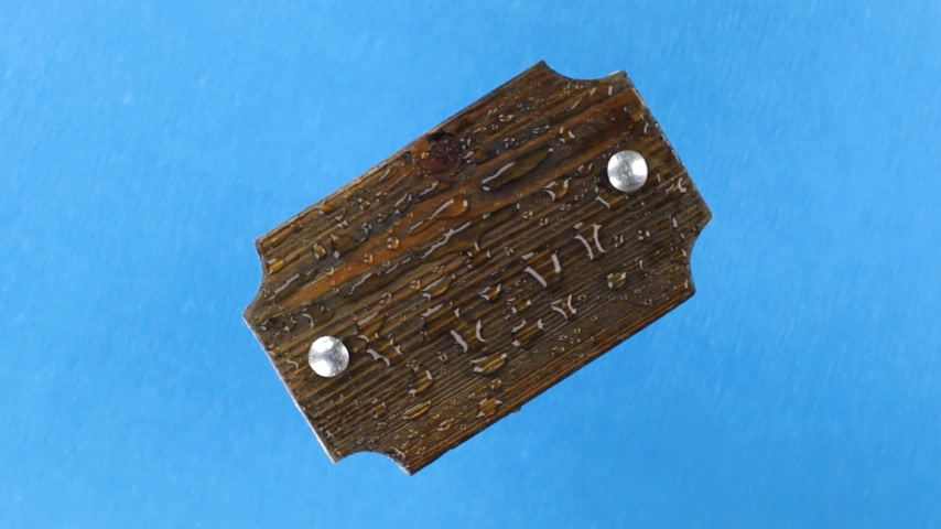 perçin : Top view, rotation of a dark wooden board with iron bolts in raindrops. Isolated Stok Video