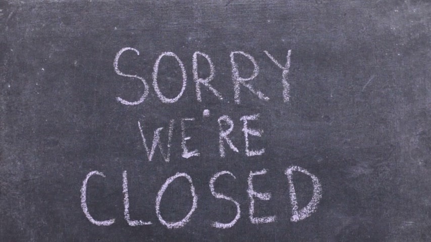 sorry : Text sorry were closed written with chalk on old blackboard. Stock Footage