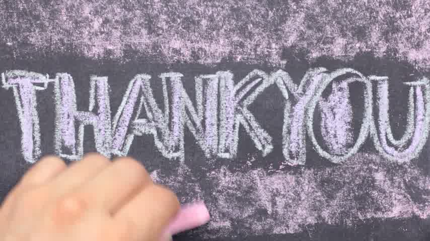 handschrift : Word thank you written with chalk on blackboard.