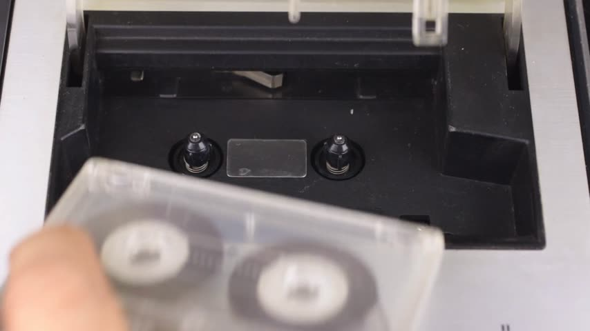 casette : Retro technology. The person stops the tape from the tape