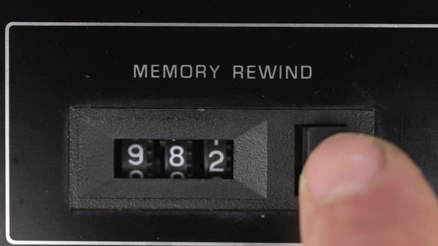casette : Finger resets to zero the readings of the old analog counter. Retro concept.