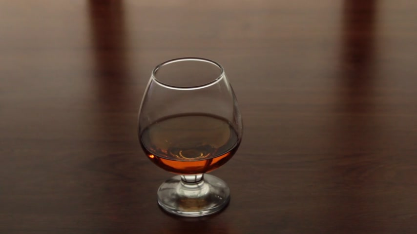 bourbon whisky : Panorama, glass goblet with cognac, standing on the kitchen table.