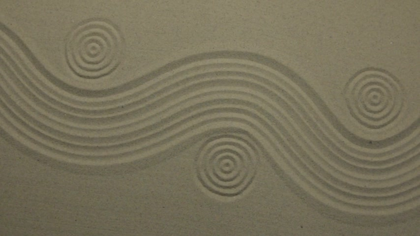 zigzag : Unusual sand texture. Drawn waves and circles in the sand. With space.