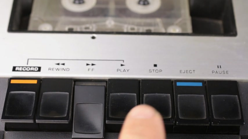 eject : Finger pressing the rewind button and stop. Retro cassette tape player. Stock Footage