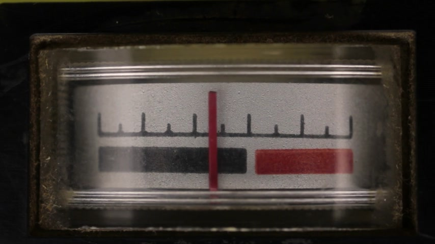 Close-up. Analog arrow indicator on the panel. Old analog arrow indicators on the player.