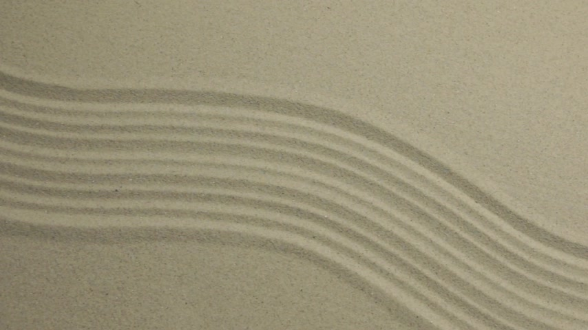 засушливый : Unusual sand texture. Drawn lines and zigzags in the sand. With space. Стоковые видеозаписи