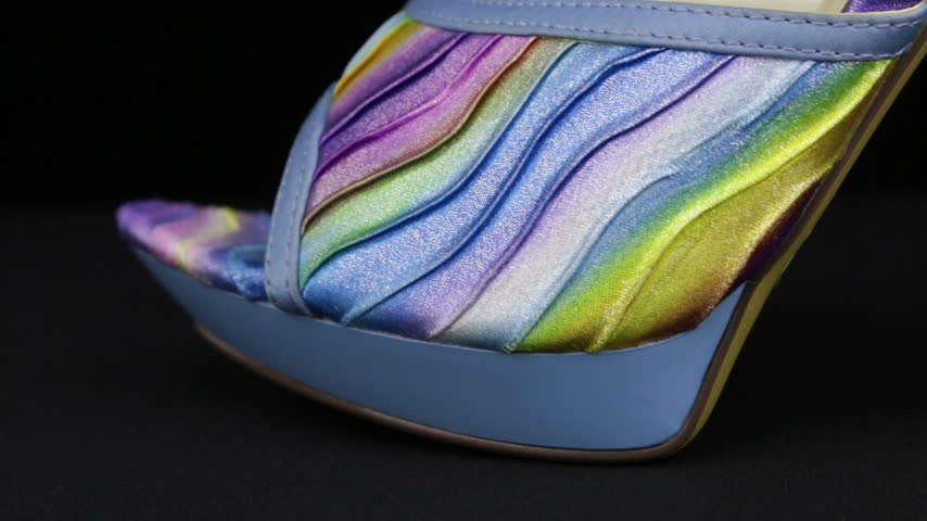Close-up. Panorama from toe to heel of blue female high-heeled clogs. Stock Footage