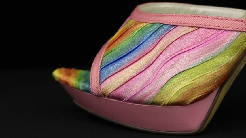 Close-up. Panorama from toe to heel of pink female high-heeled clogs.