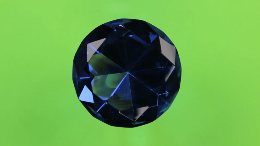 Rotation of a large blue rhinestone on a green screen. With space for design, text place. Stock Footage