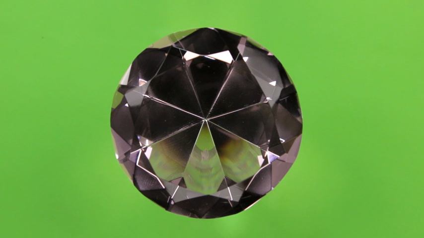Rotation of a large pink rhinestone on a green screen. With space for design, text place.