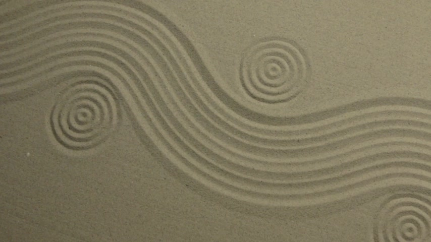 Circles and curve lines on the sand. Crane shot. Top view. Summer background.
