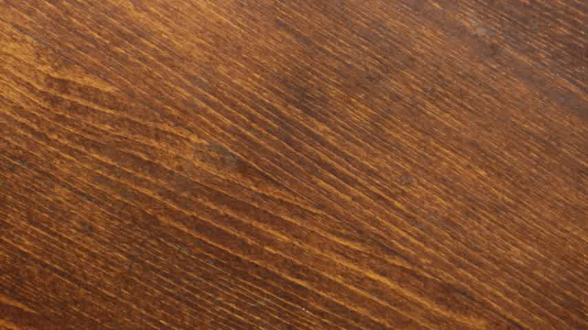Brown wooden texture background. Rotation. Brown wood surface.