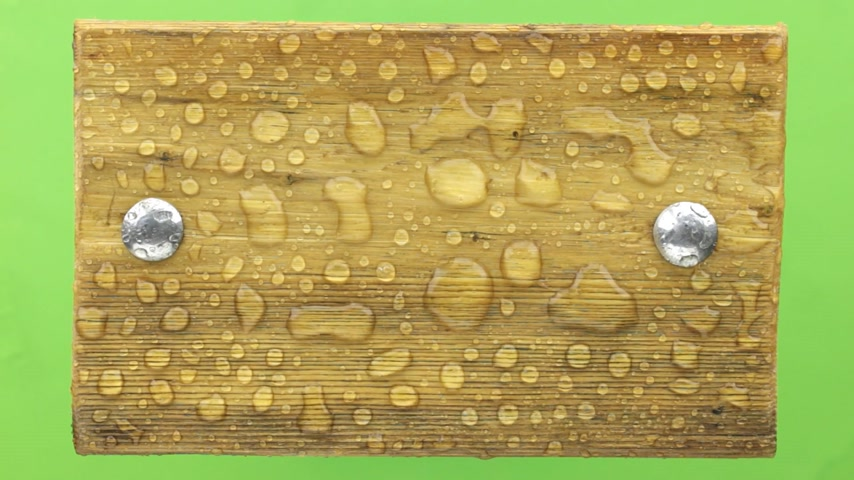 Wind shakes water drops on a wooden board with iron bolts, isolated. Stok Video