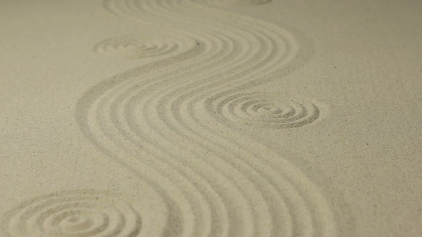 Approximation circles and curve lines on the sand. Summer background.