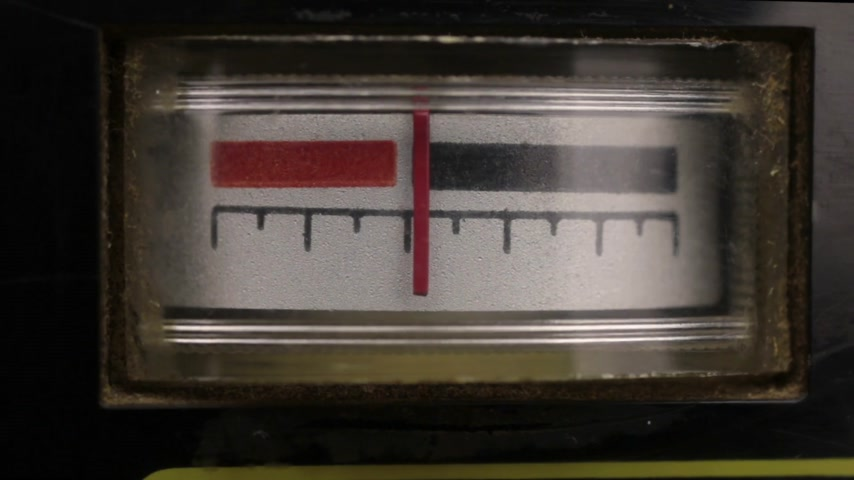 indicating : Close-up. Analog arrow indicator on the panel. Old analog arrow indicators on the player.