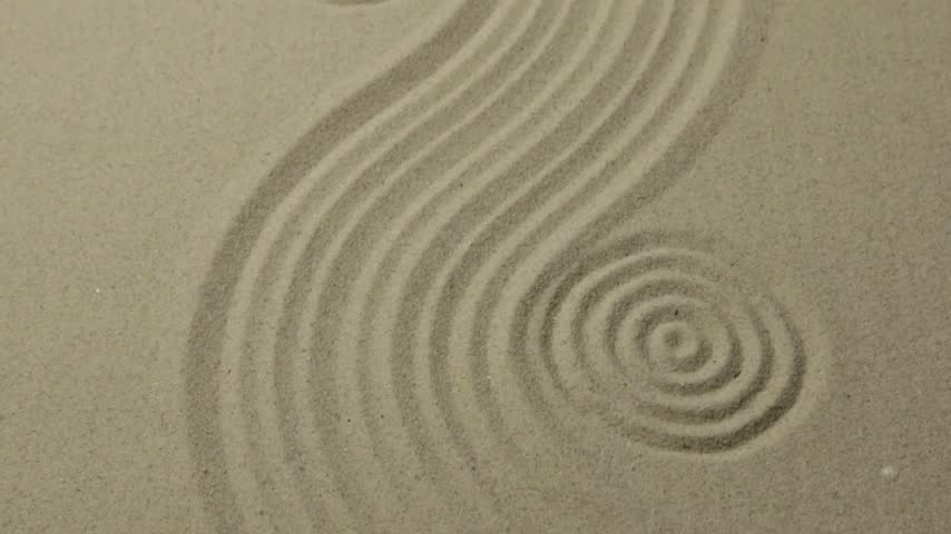 concêntrico : Panorama. Circles and curve lines on the sand. Texture of sand.