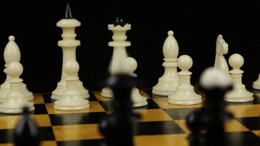 turn table : Chess pieces on a chessboard table. Panorama. Stock Footage