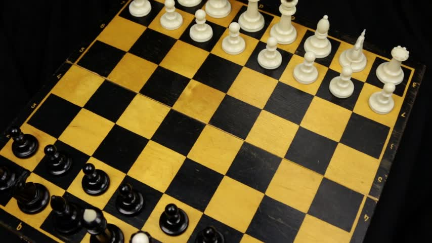 Chess pieces on a chessboard table. Panorama. Stok Video
