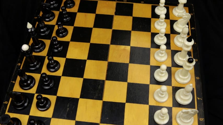 Chess pieces on a chessboard table. Panorama. Stock mozgókép