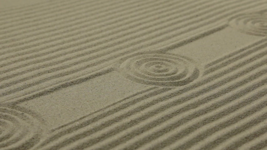 Circles and lines on the sand. Texture of sand. Slider shot.