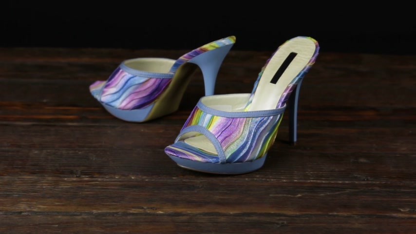 high heeled sandals : Blue clogs with high heels and a platform on a wooden background.