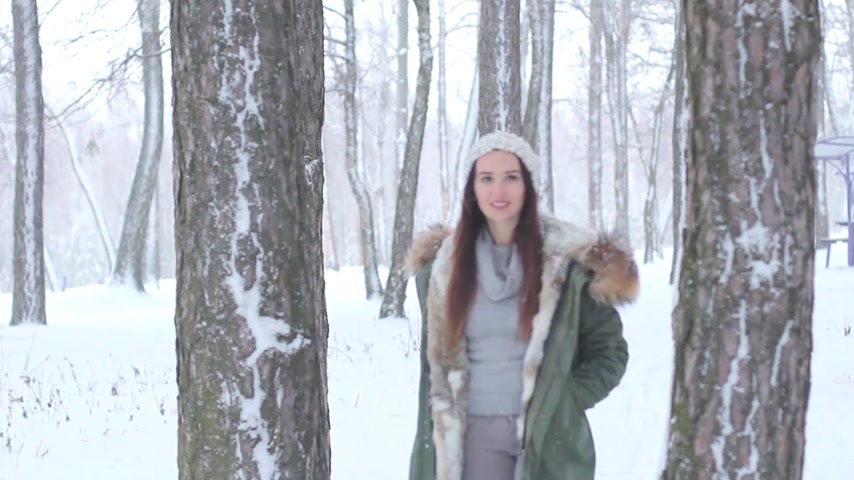 fur boots : girl posing in the forest snow
