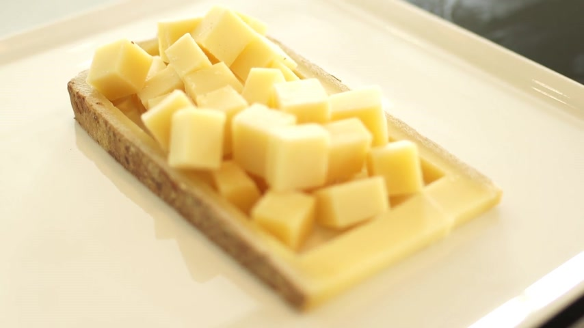 emmental : sliced slices of cheese on the Board Stock Footage