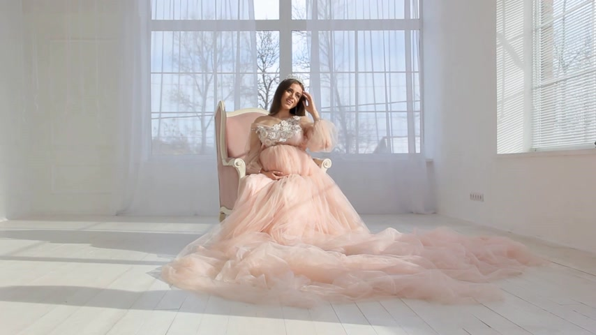 pregnancy : beautiful young pregnant girl in pink long dress
