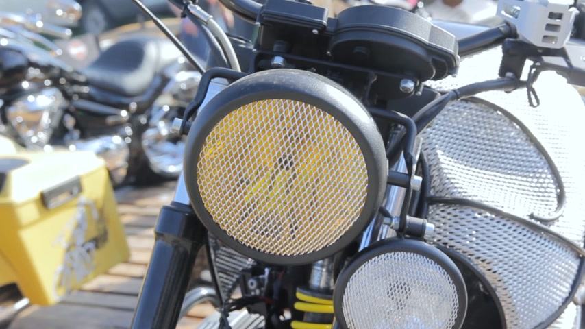 benzine : Detail of the headlight of a classic motorcycle